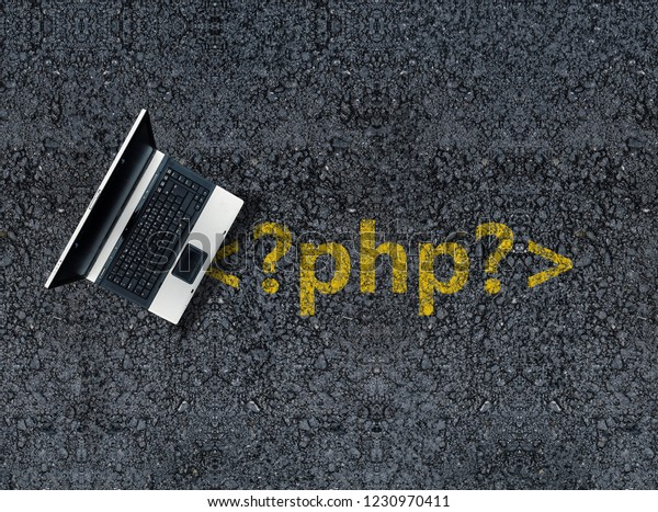 php programming language. Laptop on php tag drawn with paint on road asphalt