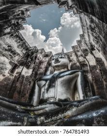 Phra Achana, large stucco Buddha image at Wat Si Chum, Sukhothai, Thailand