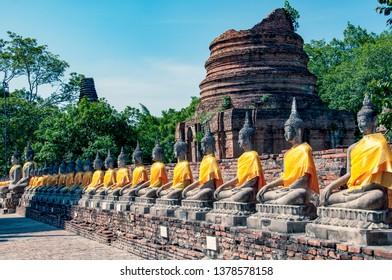 Phra Nakhon Si Ayutthaya. Thailand. 12/03/2018. Wat Yai Chai Mongkhon. Alignment of Buddha Statue