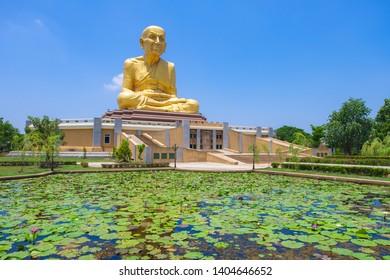 PHRA NAKHON SI AYUTTHAYA, THAILAND - MAY 20, 2019: Big golden Luang Pu Thuat Statue at Maharat Buddhist Park in Phra Nakhon Si Ayutthaya province.