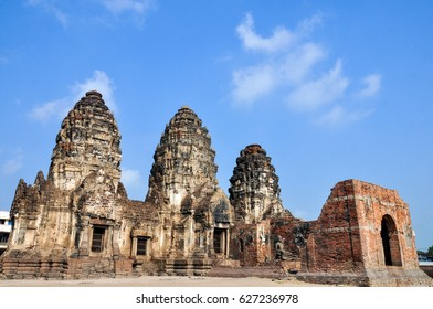 phra prang sam yod on blue sky and white cloud  lopburi , thailand. space for text. historical sites to study the history of the past.