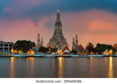 Phra Prang Wat Arun in Thailand, Bangkok famous landmark in Thailand. Landscape of beautiful temple along the Chao Phraya river at twilight.