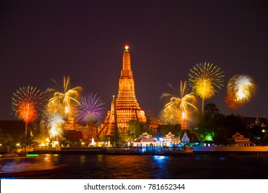 Phra Prang Wat Arun waterfront  with Beautiful Fireworks new year celebration at twilight time in Bangkok, Thailand the most famous tourist destination landmark.. Happy New Year concept