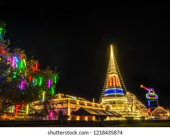 Phra Samut Chedi, one of the famous sacred Buddhist pagoda of Samut Prakan, Thailand. - Decorative with festive lights with one section as Thai flag for the famous tradition of the pagoda celebration.