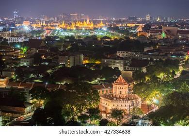 Phra Sumen Fort with grand palace at night , Bangkok Thailand .