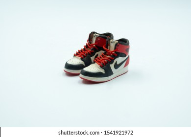 Phrae Thailand /26/10/2019 : The Small Figure of Air Jordan 1 Black Toe Sneakers  Isolated on White Background