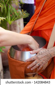 PHRAE, THAILAND - OCT 31 : Unidentified Buddhist monks are given food offering from people in the morning for End of Buddhist Lent Day. on October 31, 2011 in Muang, Phrae, Thailand.