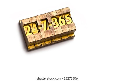 """The phrase """"24-7-365"""" done in brass type on a white paper background."""