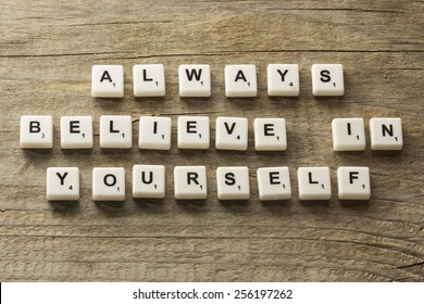 phrase always believe in yourself, over wooden background