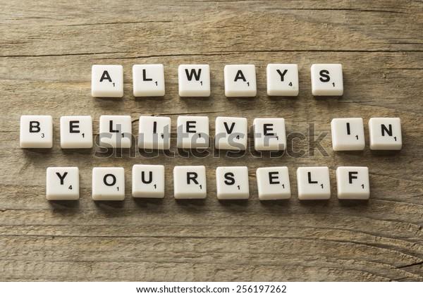 phrase always believe in yourself, over wooden background