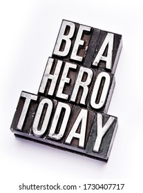 """The phrase """"Be A Hero Today"""" in letterpress type. Cross processed, narrow focus."""