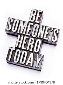 """The phrase """"Be Someone's Hero Today"""" in letterpress type. Cross processed, narrow focus."""