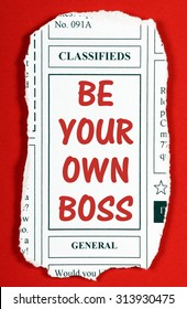 The phrase Be Your Own Boss in red text on a clipping from the classified advertising section of a newspaper as an invitation to start your own business