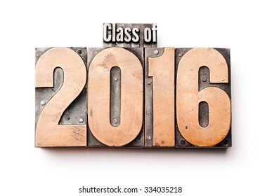 """The phrase """"Class of 2016"""" in letterpress type. Cross processed, narrow focus."""