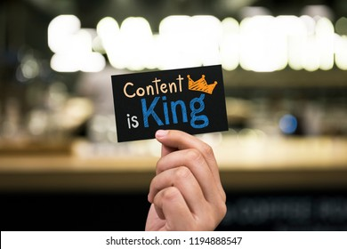 Phrase Content is king written on a card