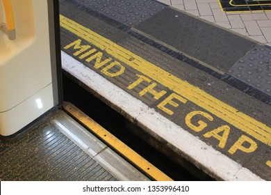 """""""MIND THE GAP"""" phrase denoted by the famous London Underground yellow words symbolising the gender pay gap and London tourism"""