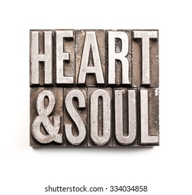 "The phrase ""Heart & Soul"" in letterpress type. Cross processed, narrow focus."