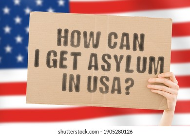 """The phrase """" How can I get asylum in USA """" on a banner in men's hand with blurred American flag on the background. Claim. Refugee. Immigration. Law. Legislation"""