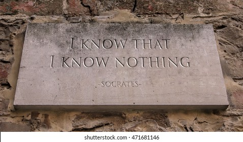 The phrase I know that I know nothing, sometimes called the Socratic paradox, is a saying that is derived from Plato's account of the Greek philosopher Socrates. Engraved text.