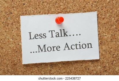 The phrase Less Talk, More Action on a cork notice board as the motivation to getting things done at work or at home
