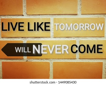 "Phrase ""Live like tomorrow will never come"" on brown rectangular brick wall"
