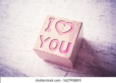 Phrase I Love You With A Heart Icon Engraved On A Wooden Block On A Table