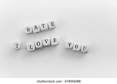 Phrase I love you spelled by dice. Word Hate