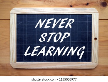 The phrase Never Stop Learning in white text on a blackboard as a reminder to continue with your education
