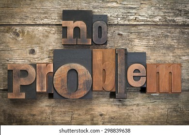 """phrase """"no problem"""" written with vintage letterpress printing blocks on rustic wood background"""