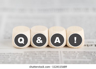 The phrase q&a on cubes on a newspaper