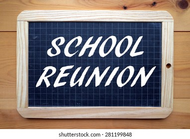 The phrase School Reunion in white text on a slate blackboard