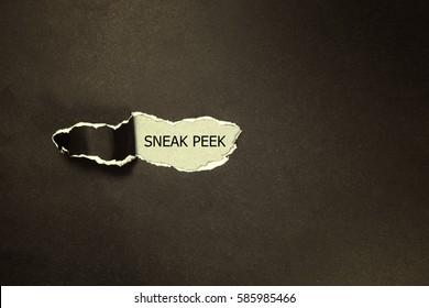 The phrase Sneak Peek appearing behind torn black paper
