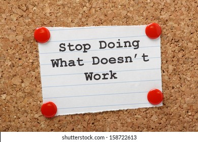 The phrase Stop Doing What Doesn't Work on a paper note pinned to a cork notice board. In both business and our own lives we have to look for efficiency and best practice to move forward.