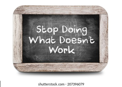 The phrase Stop Doing What Doesn't Work on chalkboard