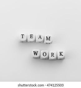 Phrase Team work spelled by dice