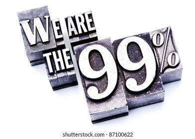"""The phrase """"We are the 99%"""" in letterpress type. Cross processed, narrow focus."""