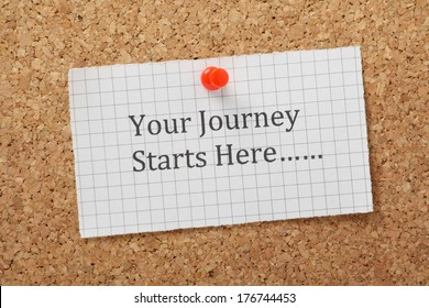 The phrase Your Journey Starts Here typed on a piece of graph paper and pinned to a cork notice board