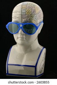 Phrenology head with child's sunglasses