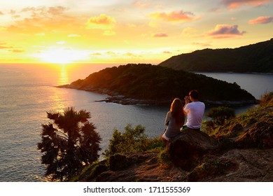 Phrom Thep Cape, Phuket Province, Thailand, 22 November 2017 : the tourists in a beautiful sunset period at Phuket Island, one of the most famous ocean attraction in the Andaman Sea of Thailand.