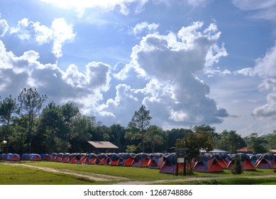 Phu Kradueng, Loei / Thailand - 11 13 2018 : rows of tents under scenic sky for tourist to rent at Wang Kwang Camping Area, Phu Kradueng, Loei / Thailand.