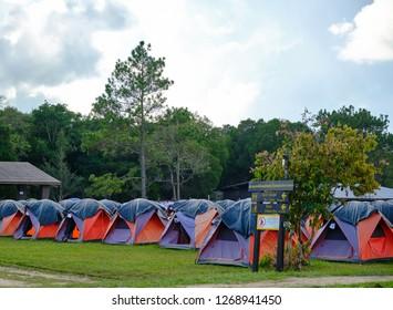 Phu Kradueng, Loei / Thailand - 11 13 2018 : rows of tents in camping area at Wang Kwang Camping area in Phu Kradueng, Loei / Thailand.