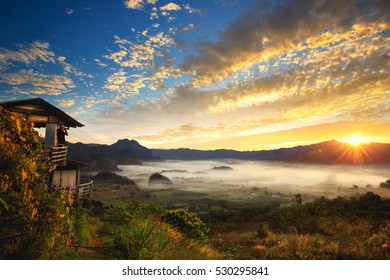Phu Langka national park, The landscape of misty mountains and at sunrise, Phayao Northen Thailand, A photographer or traveller using a professional DSLR camera in the nature for background.