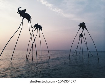 PHU QUOC VIETNAM 30.01.2017 Sculptures of elephants based on Dali are in the ocean at sunset