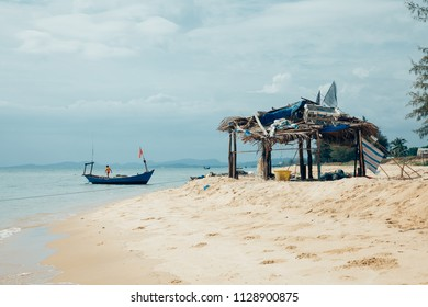 Phu Quoc, Vietnam - April 6, 2014: A local boy working on a fishing boat at the beach in Phu Quoc island, Vietnam on April 6, 2014.