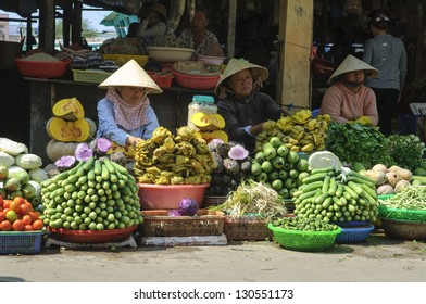 PHU QUOC, VIETNAM - FEB 17: Local farmers selling fresh produce at the farmer market on February 17, 2013 in Phu Quoc, Vietnam. This market is held daily and is the biggest on the island.