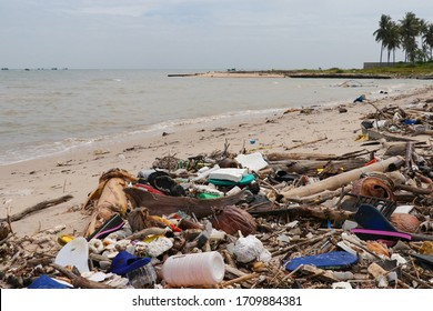 PHU QUOC, VIETNAM - FEB 8, 2020: Pollution: Garbages, plastic, and wastes on the beach of tropical sea. Environmental pollution. Sand beaches polluted with pieces of plastic waste.