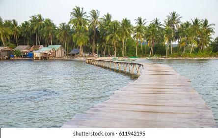 Phu Quoc, Vietnam - Mar 20, 2017: Scene of wooden long bridge and life at Rach Vem fishing village of Ganh Dau beach in Phu Quoc island, south Vietnam.