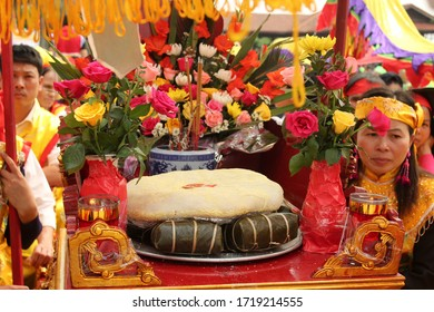 Phu Tho / Vietnam - 13 April 2013: Chung cake (Banh Chung), Giay cake (Banh giay) - Vietnamese traditional cake for lunar new year in a festival
