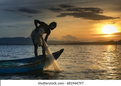 Phu Yen province, Viet Nam - July 8, 2017:  Fishermen are throwing fishing nets into on the river in the sunset in Phu Yen province, Vietnam
