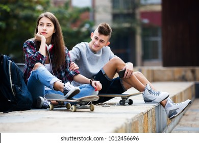 Phubbing: portrait of teenager girl and boy asking for attention